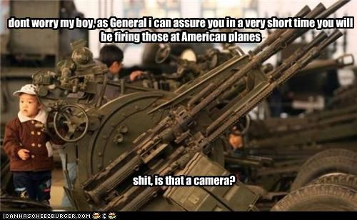 dont worry my boy, as General i can assure you in a very short time you will be firing those at American planes shit, is that a camera?