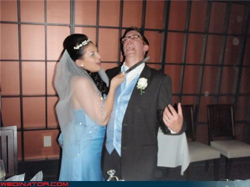 bride,bride pretends to stab groom,cake knife,Crazy Brides,crazy groom,Dreamcake,eww,fashion is my passion,funny wedding photos,groom,I Dream of Jeannie,role playing,surprise,were-in-love,weird bridal attire,wife stabbing groom in throat,wtf