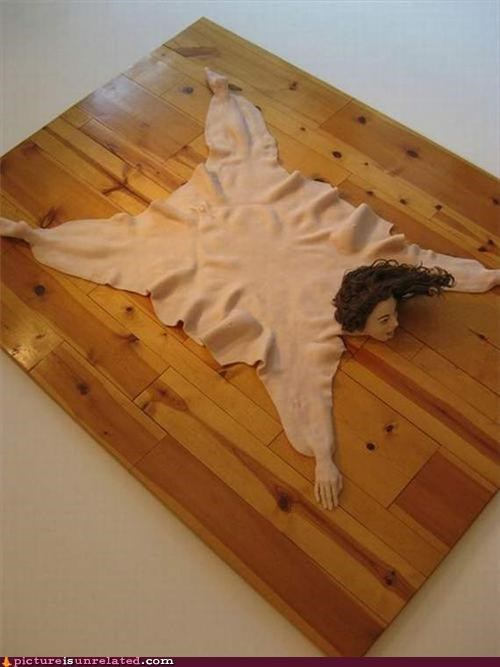 blow-up doll,disturbing,human skin,rug,wtf