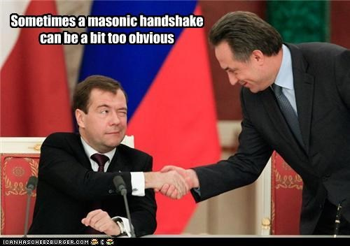 Dmitry Medvedev,handshakes,masons,obvious,russia,subtlety,wink