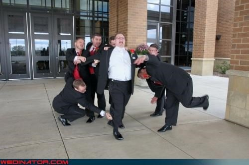 crazy groom,funny groom picture,funny groomsmen picture,funny wedding photos,groom,groom pretending to run,Groomsmen,groomsmen hold groom back,runaway groom,wedding party
