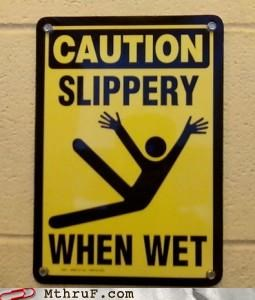 caution falling signs slippery when wet