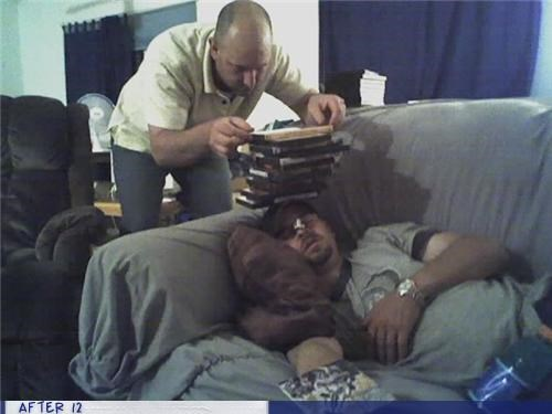 passed out,stack dvds couch