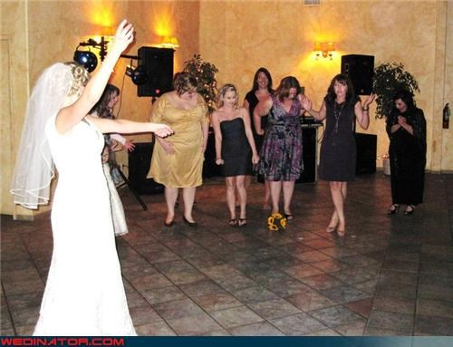 all the single ladies,bouquet toss,bride,catching the bouquet,Crazy Brides,fashion is my passion,funny bouquet toss picture,funny bride picture,funny wedding photos,miscellaneous-oops,surprise,unwanted bouquet
