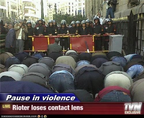 Pause in violence - Rioter loses contact lens