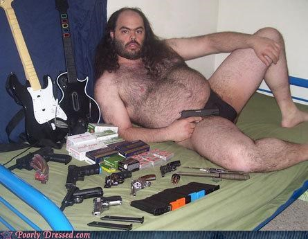 bald,Guitar Hero,guns,pistol,rockband,speedo,weird,wtf