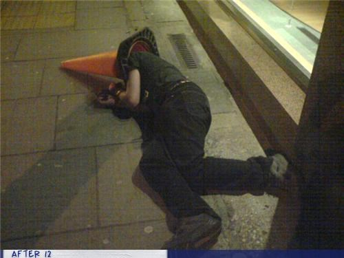 cone conehead passed out sidewalk street - 4416485632