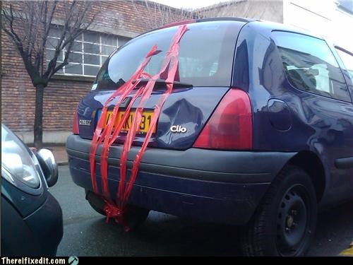 cars,holding it up,tape,wtf