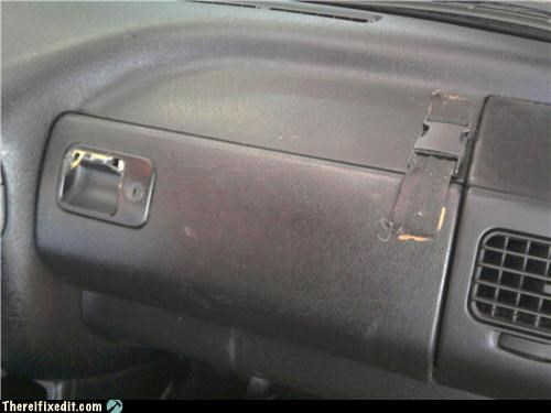 cars glovebox holding it up seatbelt