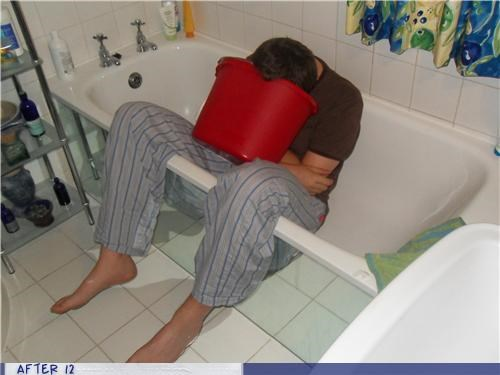 bathroom,bucket,passed out,puke,tub