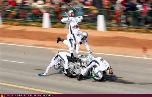 archery costume motorcycle stunts wtf - 4468829184