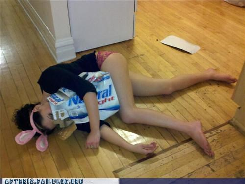 beer,box,bunny ears,cardboard,costume,drunk,floor,girl,passed out