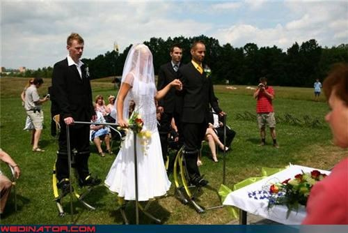 bizarre funny wedding photos jumping stilts tall - 4524240896