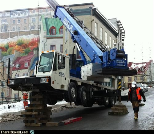 crane holding it up jacked Professional At Work - 4528323584