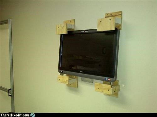 holding it up,mounted,Professional At Work,television,wall mount