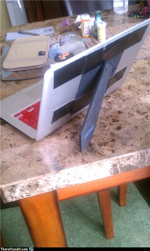 apple products,computer repair,holding it up,laptop,picture frame