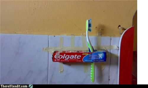 bathroom,dual use,holding it up,tape,toothbrush,toothpaste