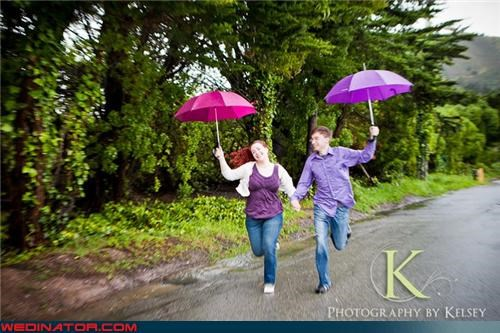 engagement photo shoot funny wedding photos running toward camera umbrella