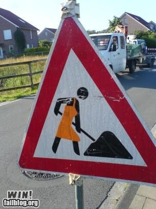 construction,feminism,hacked,road signs