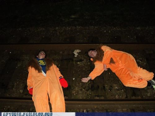bad idea,costume,passed out,suits,train tracks