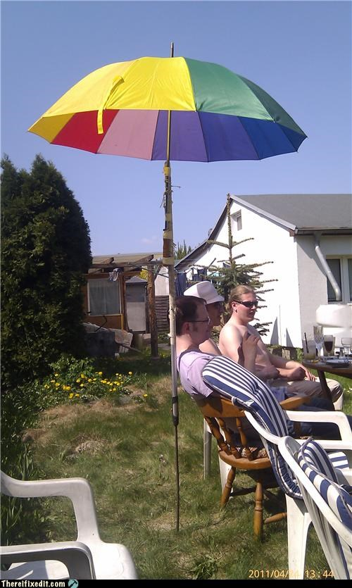 holding it up rainbow umbrella - 4688289280