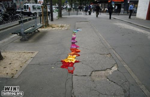 art clever hacked pot hole Street Art - 4693065216