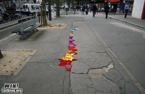 art clever hacked pot hole Street Art - 4693065216