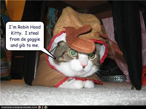 caption,captioned,cat,costume,credo,dogs,dressed up,give,robin hood,steal