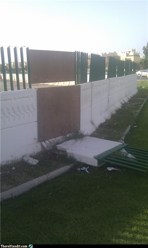 fallen,fence,holding it up,poorly built