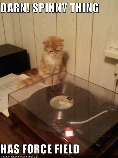 caption,captioned,cat,darn,forcefield,record player,spinning,spinny,tabby,thing,upset