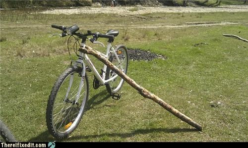 bicycle,bike,holding it up,kickstand,overkill,poll,unnecessary,woody