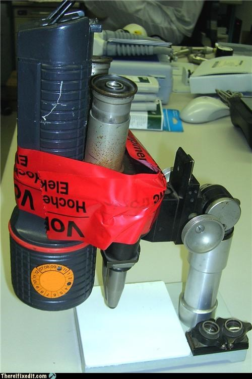 flashlight holding it up Mad Science Monday microscope Professional At Work tape - 4776301056