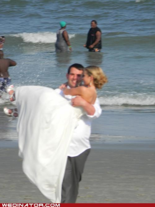 beach wedding,funny wedding photos,groom carry bride
