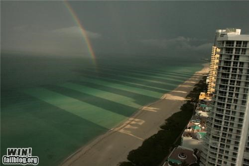 awesome beach buildings Photo rainbow shadows water