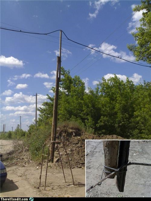 holding it up,tax dollars at work,utility pole