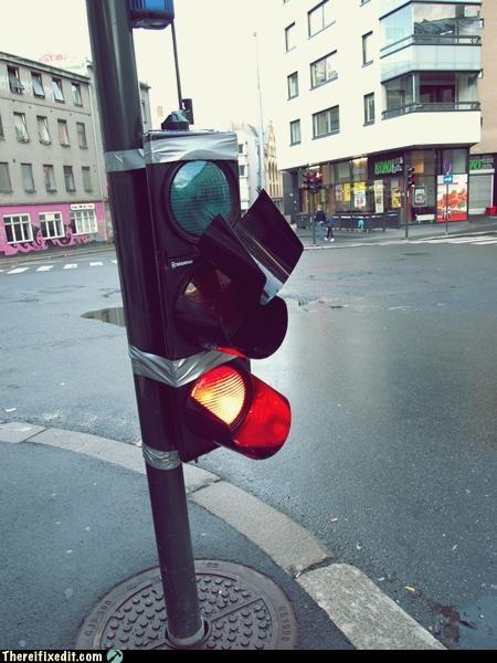 holding it up tax dollars at work traffic light - 4905875456
