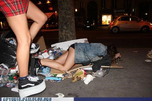 outside,passed out,shoes,sidewalk,trash