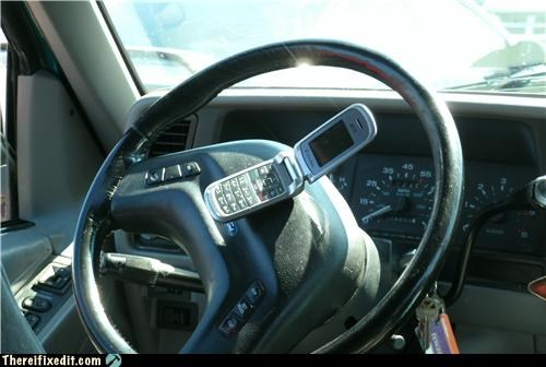 Funny fail pic of a cellphone on a steering wheel that might be a problem if that airbag goes off.