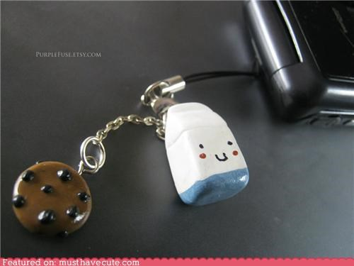 cell phone,charm,clay,cookies,face,milk,snack