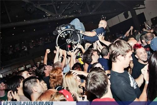 concert,crowd surfing,wheelchair