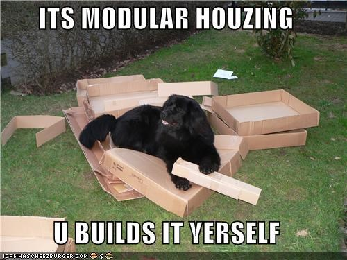 cardboard boxes construction destruction mess modular housing newfoundland outdoors - 4987016704