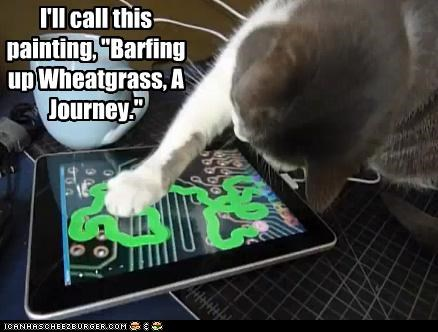 captioned funny-pictures-cat-uses-ipad - 4993283584