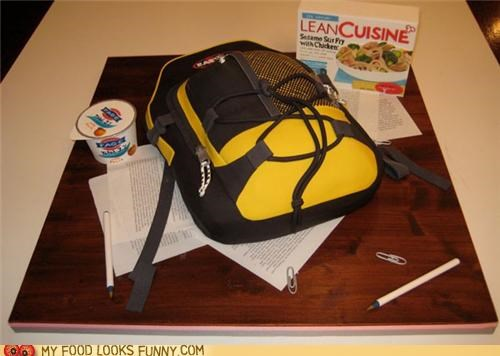 backpack,cake,lean cuisine,paper,pens,table,yogurt