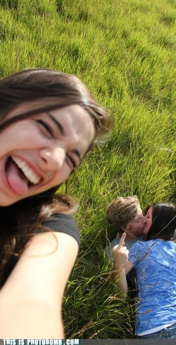 Awkward grass KISS middle finger third wheel