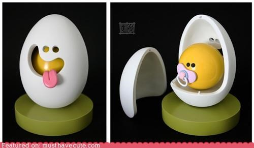 baby egg face pacifier sculpture toy yolk