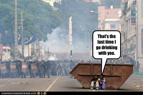alcohol drinking hiding Pundit Kitchen riot gear riots - 5013964032