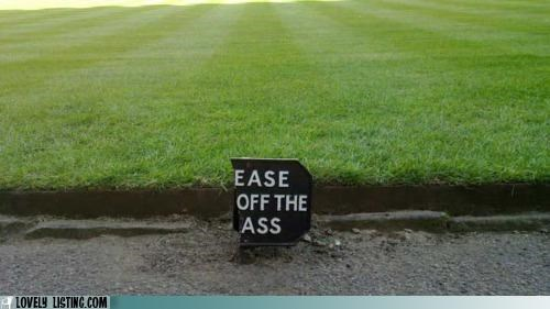 ass grass sign