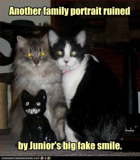 Another family portrait ruined by Junior's big fake smile.