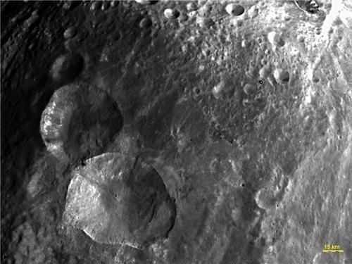 asteroid craters dawn nasa photos snowman space vesta - 5046275840