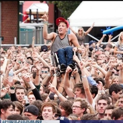 crowd surfing,teamwork,wheelchair,win